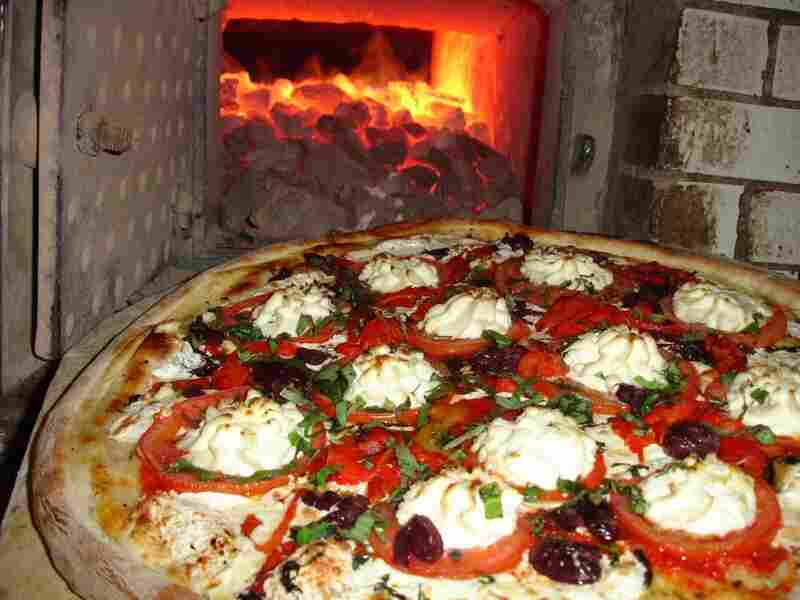 Lombardi's bakes its pizzas in a coal-burning oven. The pizzeria opened its doors in 1905 in Manhattan's Little Italy neighborhood.