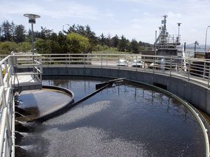 "A boom sweeps around a tank at a sewage treatment plant in Coos Bay, Ore. Even though sewage water can be treated and cleaned, psychologists say getting the ""cognitive sewage"" out of the water is much more difficult."