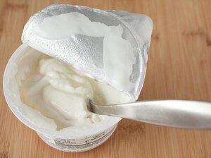 "A container of Greek yogurt is opened and ready to eat. Some argue that calling this type of yogurt ""Greek"" is simply a marketing ploy."