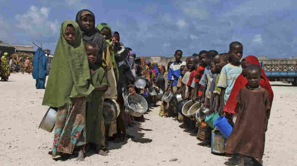 Children from southern Somalia line up to receive cooked food in Mogadishu, Somalia, Monday, Aug. 15, 2011. The U.N. estimates that only 20 percent of people needing aid are getting it in Somalia.