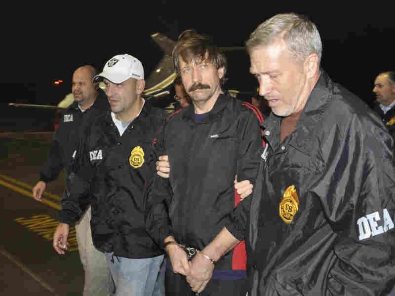 This image provided by the Drug Enforcement Administration shows Russian arms trafficking suspect Viktor Bout in U.S. custody after being extradited and flown from Bangkok to New York to face terrorism charges.