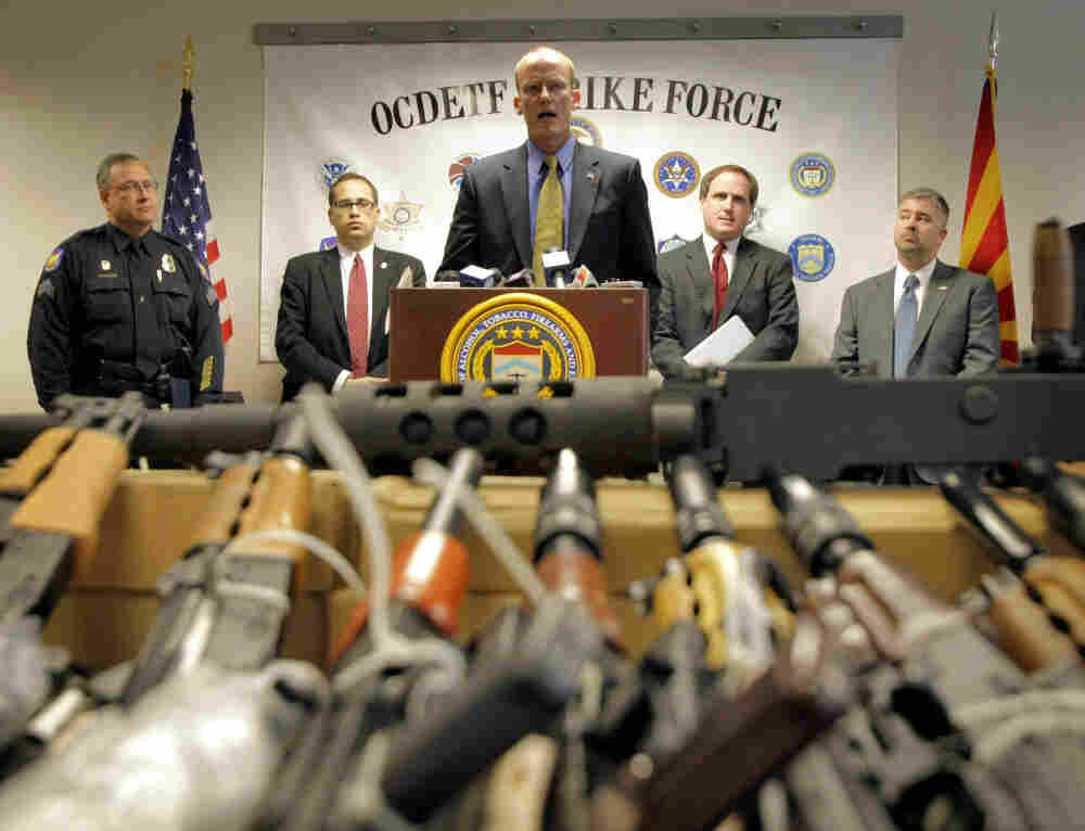 "In this Tuesday, Jan. 25, 2011 picture, Bill Newell, special agent in charge of ATF Phoenix, speaks behind a cache of seized weapons in Phoenix. The ATF is under fire over a Phoenix-based gun-trafficking investigation called ""Fast and Furious."""