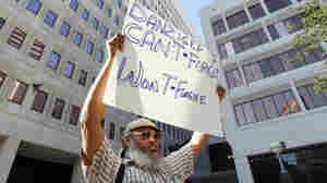 W.C. Johnson, of the group Community United for Change, protests outside federal court in New Orleans on the opening day of the Danziger trial in June. On Aug. 5, five police officers were convicted of various roles in gunning down  innocent civilians in the days after Hurricane Katrina and then  covering it up. Five other officers pleaded guilty.