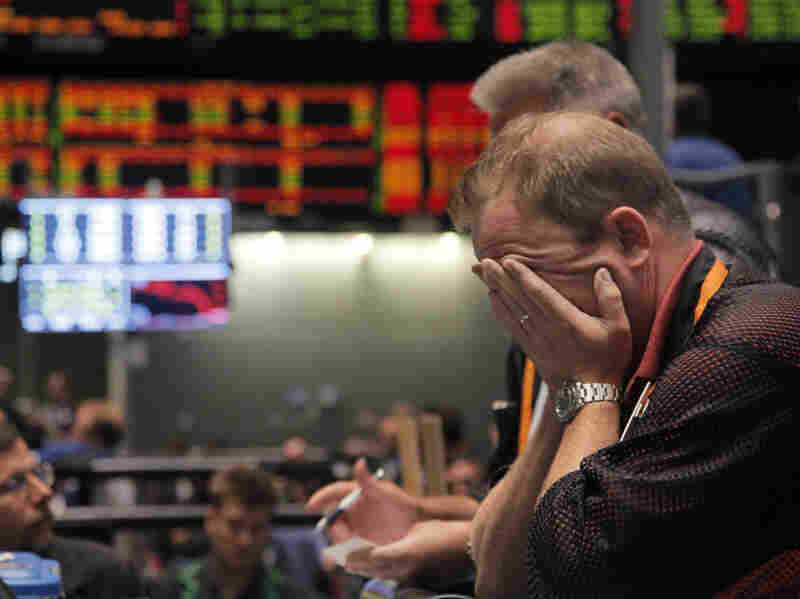 A trader reacts after the close of trading in the Nasdaq 100 Index pit on the floor of the CME Group on Aug. 8 in Chicago. Stocks plummeted after Standard & Poor's downgraded U.S. debt.