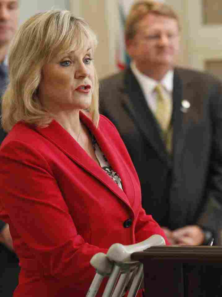 Oklahoma Gov. Mary Fallin talks about the state's response to the drought during a news conference Monday in  Oklahoma City. At right is state Emergency Management Director Albert Ashwood.