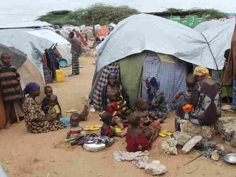 Women and children from southern Somalia rest in front of their makeshift shelters at Badbado refugee camp in Mogadishu, Somalia, Sunday, Aug. 14, 2011. The U.N. has estimated that only 20 percent of people needing aid are able to receive it because an al-Qaida-linked group controls large portions of the country.