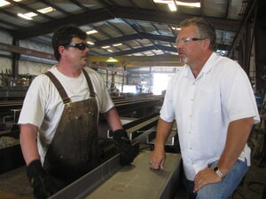 Precision Iron Works President Steve Leighton (right) says gover
