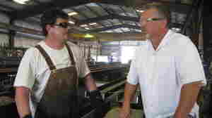 Precision Iron Works President Steve Leighton (right) says government regulations are keeping his company from growing.