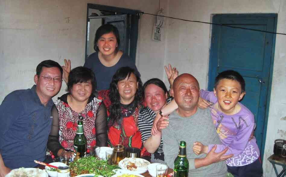 Mandy with her  father  (far left) and other relatives, on her recent trip back to  China.  Her parents think it's important for her to connect with her  relatives, but she  often feels like she doesn't have much to say around  them.