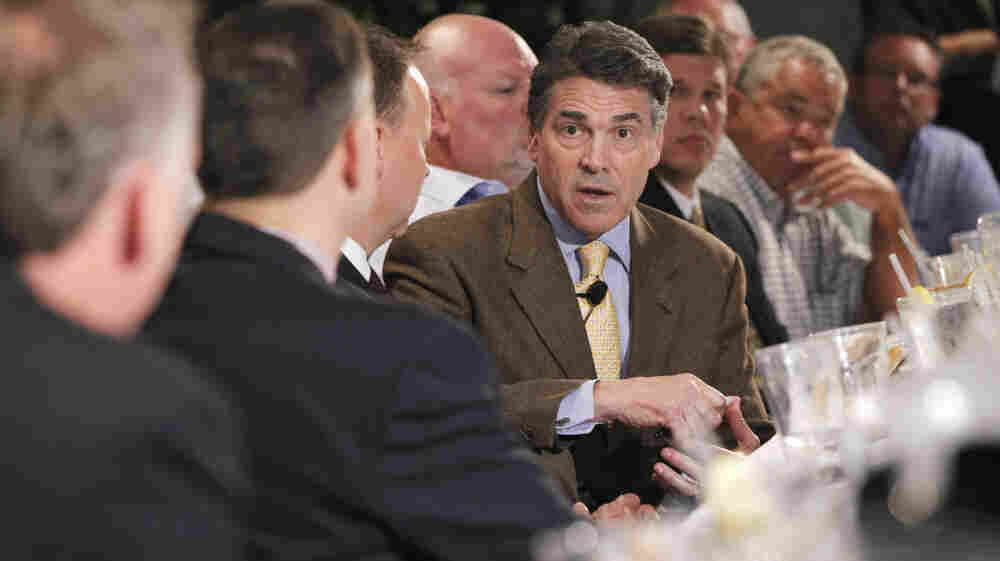 Republican presidential candidate Texas Gov. Rick Perry meets with business leaders at a lunch in Dubuque, Iowa, on Tuesday.