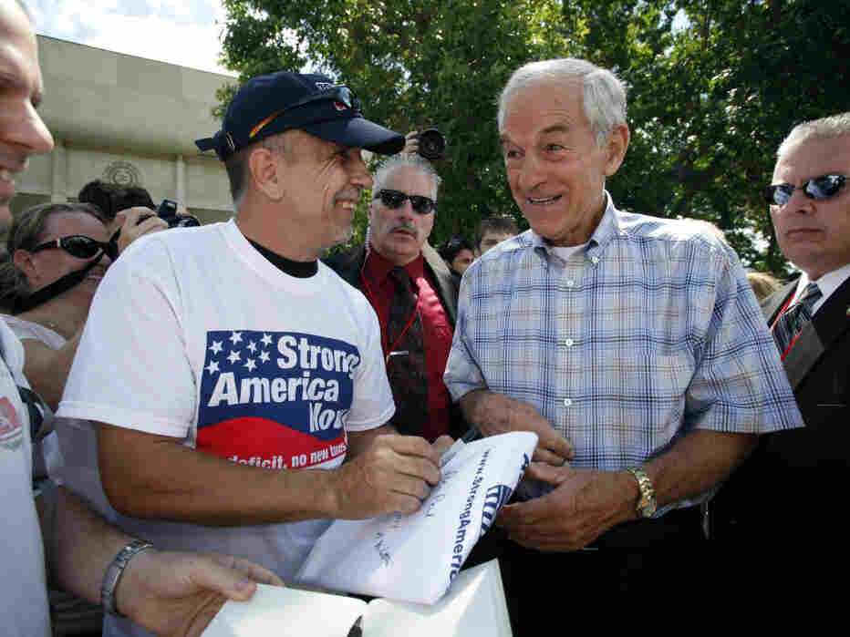 Rep. Ron Paul signs an autograph during the Ames Straw Poll, in  Iowa, Saturday, Aug. 13, 2011.