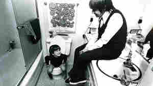 """Andrew doesn't like to go to the bathroom alone. From the """"Suburbia"""" series, 1972"""