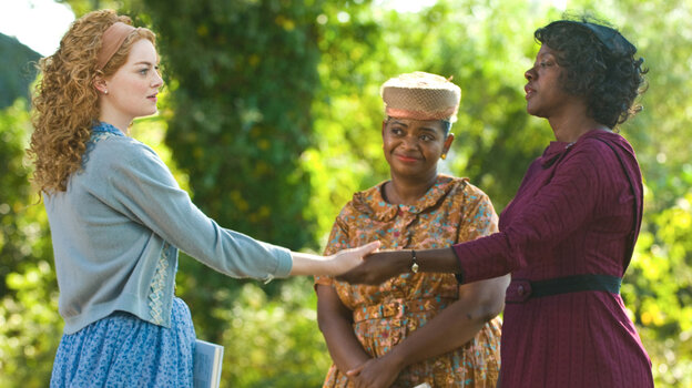 In Jackson, Miss., in 1963, three very different women — from left, Skeeter Phelan (Emma Stone), Minny Jackson (Octavia Spencer) and Aibileen Clark (Viola Davis) — build an unlikely friendship around a secret writing project in The Help, based on the novel by Kathryn Stockett.