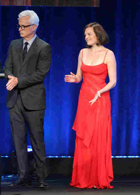 "I loved this dress on Elisabeth Moss — seen here, also at the TCA Awards, with John Slattery as Mad Men accepts for Outstanding Achievement In Drama. I have to admit — I saw her in the ladies' room earlier in the evening and I really, really almost said, ""Holy cow, I love that dress."" But you can't really do that in that setting. So I'm doing it now."