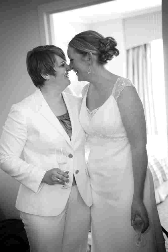 Bernadette Coveney Smith, left, shares a special moment with her wife Jennifer Coveney Smith, right, during their wedding.
