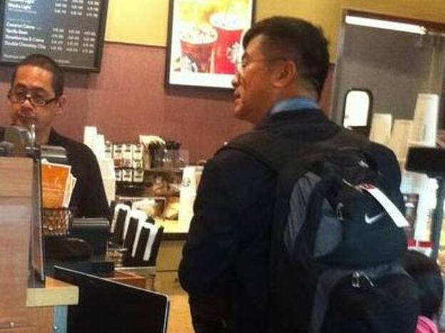 U.S. ambassador to China Gary Locke carries his own backpack and orders his own coffee on Friday Aug. 12 at Seattle-Tacoma International Airport.