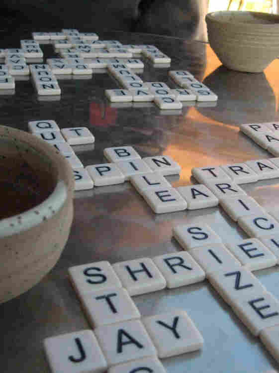 "Players form words from a pile of tiles in the center. Once all the tiles have been picked, the first to finish yells ""Bananas!"""