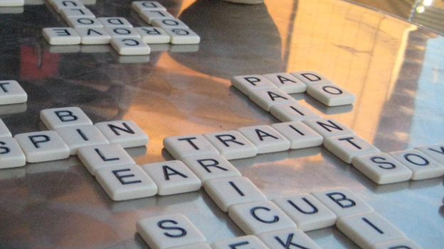 """Players form words from a pile of tiles in the center. Once all the tiles have been picked, the first to finish yells """"Bananas!"""" (Flickr/<a href=""""http://www.flickr.com/people/moonlightbulb"""">moonlightbulb</a>)"""