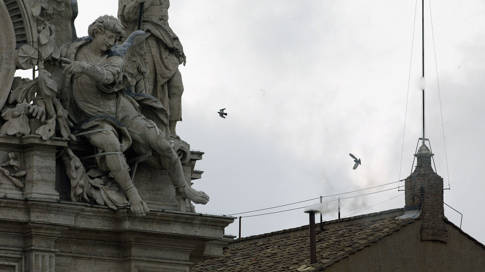 White smoke is seen from the roof of the Sistine Chapel indicating that the College of Cardinals has elected a new pope on April 19, 2005, in Vatican City.