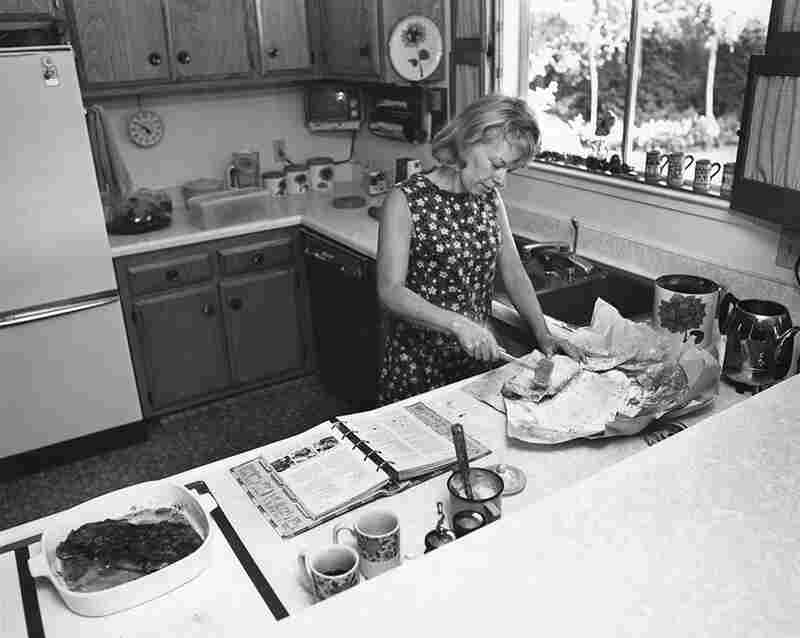 "I love to cook. Meal time is the only time the family has together. In spite of my modern kitchen, cooking dinner for six takes two hours. Then the kids inhale the food in minutes. After they are grown maybe they will remember the meals that their mother cooked. From the ""Suburbia"" series, circa 1972"