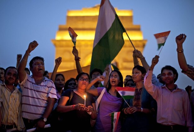 Supporters of India's most prominent anti-corruption crusader Anna Hazare gather in a show of solidarity near the India Gate memorial in New Delhi, India on Wednesday.