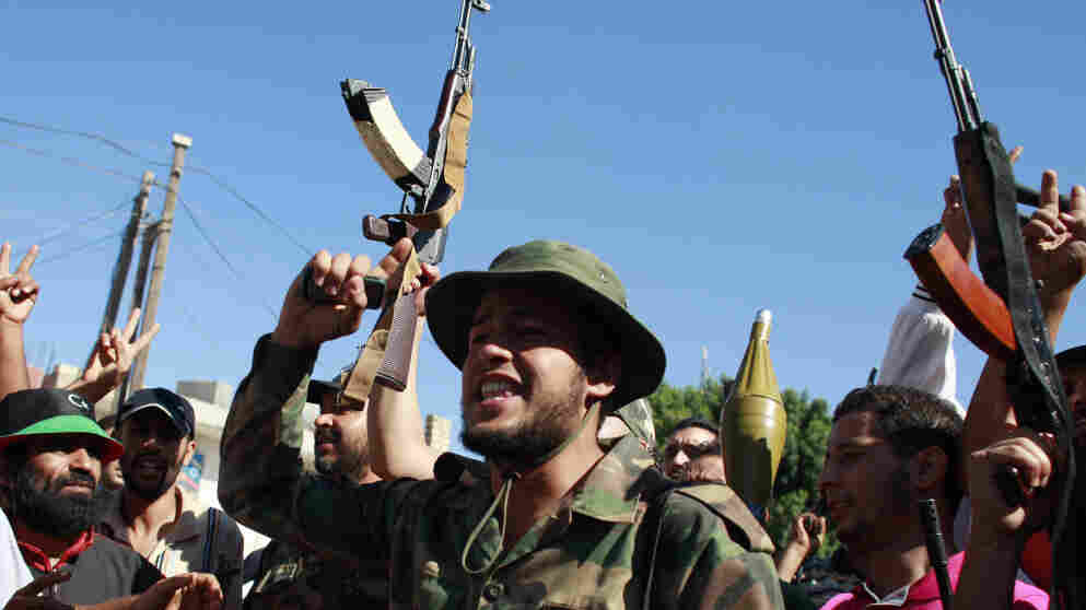 Rebel fighters celebrate on Aug. 14 after taking partial control of the coastal town of Zawiya, 30 miles west of Tripoli, the capital. If the rebels can establish full control of the town, it would cut Moammar Gadhafi's main link to the outside world.