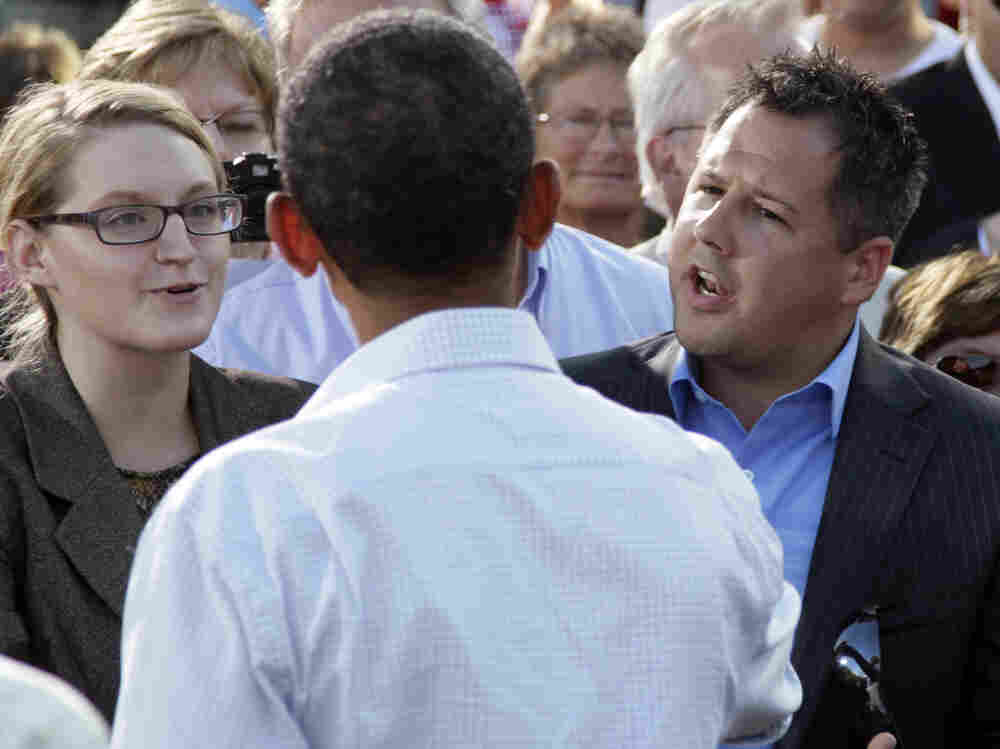 President Obama talks with Ryan Rhodes of the Iowa Tea Party Revolution and an unidentified woman in Decorah, Aug. 15, 2011.