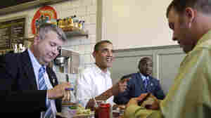 President Barack Obama talks as he has lunch at The Old Market Deli in Cannon Falls, Minn., during his three-day economic bus tour.