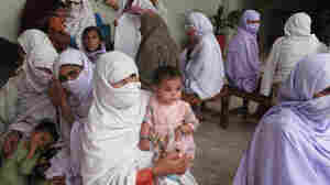 Women and children fill the waiting room of the Umrana Mumtaz Healthcare Trust  Hospital in northwest Pakistan. The private medical clinic is leveraging  technology and the Internet to serve tens of thousands of patients a year who  otherwise would have little or no medical care.