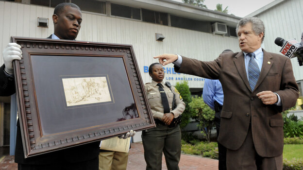 Los Angeles Sheriff lead detective Clarence Williams, left,  and Los Angeles County sheriff's spokesman Steve Whitmore, right, display the recovered $250,000 quill pen Rembrandt dra