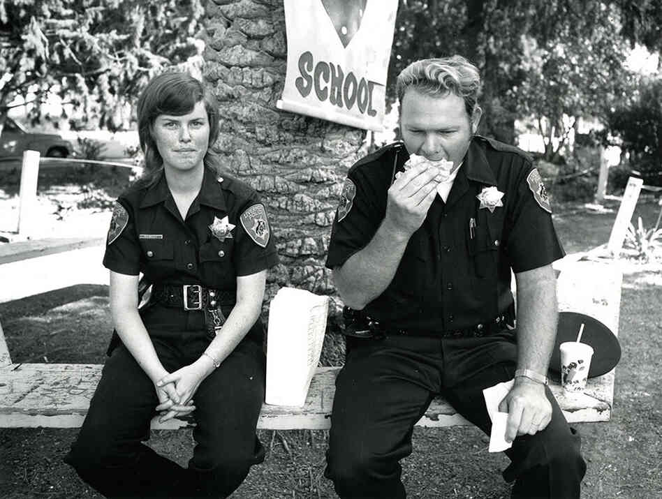 """Untitled (two police officers having lunch), from the """"Temporary Organizations"""" series, circa 1975"""