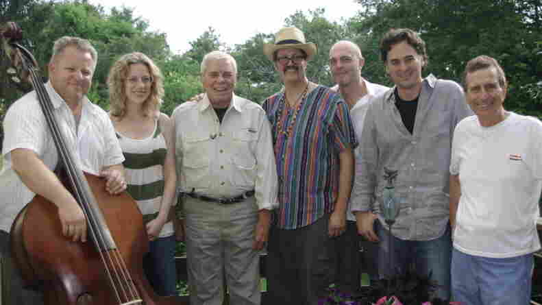 Tom T. Hall (third from left) poses with some of the collaborators who helped remake Songs of Fox Hollow, including co-producers Eric Brace (third from right) and Peter Cooper (second from right).