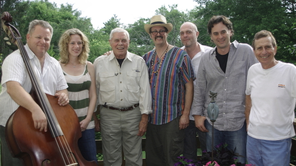 Tom T. Hall (third from left) poses with some of the collaborators who helped remake <em>Songs of Fox Hollow</em>, including co-producers Eric Brace (third from right) and Peter Cooper (second from right).