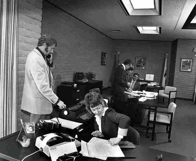 "Untitled (office scene, woman and staple action), from the ""Working (I Do It For The Money)"" series, circa 1976-1977"