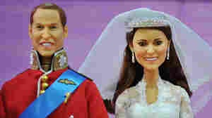 Dolls modelled on Britain's Prince William and Catherine, the Duchess of Cambridge on their wedding day.