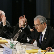 BRAC Commission Chairman Anthony J. Principi, and other member of the commission raise their hands in favor of closing Walter Reed Army Medical Center in Washington during a base closing hearing Aug. 25, 2005 in Arlington, Va.