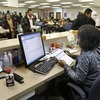 Michigan Department of Human Services caseworker Sandy Satchel works at the Family Independence Agency in Detroit. In the past few years, welfare caseloads have dropped 2 percent in Michigan while unemployment has risen 54 percent, a trend that's reflected in other states.