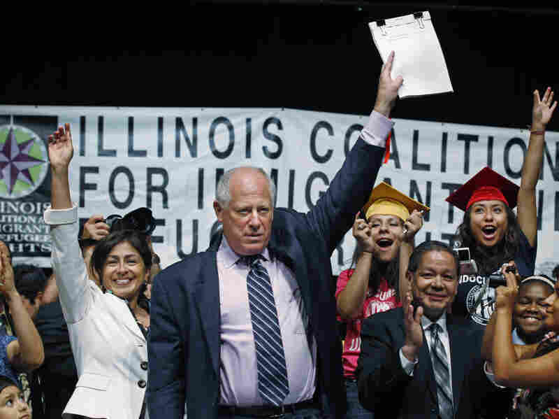 Illinois Gov. Pat Quinn celebrates with students and supporters after signing the Illinois DREAM Act into law on Aug. 1. In May, Quinn became the first of several governors to withdraw his state from the Secure Communities program that deports undocumented immigrants.