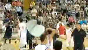 A screengrab from a video shot from the stands shows a Chinese player raising a chair above his head.