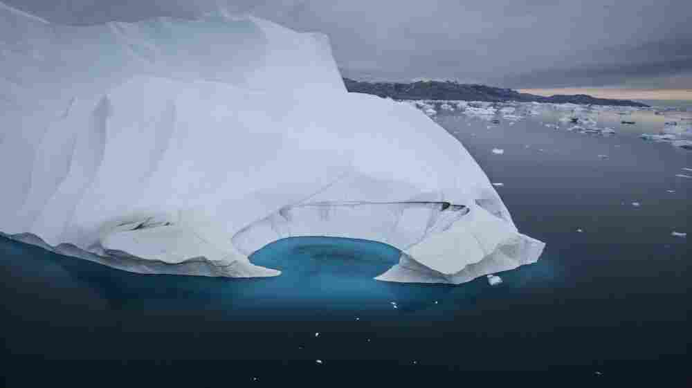 An iceberg is seen melting off the coast of Ammasalik, Greenland, in July 2007. This year, scientists say sea-ice extent in the Arctic has reached its lowest level since monitoring by satellite began in 1979, the result of rising temperatures.