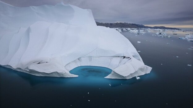 An iceberg is seen melting off the coast of Ammasalik, Greenland, in July 2007. This year, scientists say sea-ice extent in the Arctic has reached its l