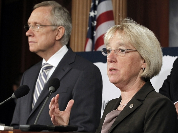 In this July 27 file photo, Sen.  Patty  Murray speaks as Senate Majority Leader Harry Reid listens at a news  conference on Capitol Hill. Reid announced earlier this month he's naming Murray to co-chair a powerful supercommittee charged  with finding more than $1 trillion in deficit cuts this fall.