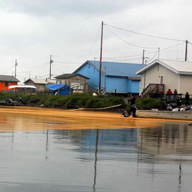 "A photo taken on Aug. 3 shows an orange mass floating on the water at Kivalina, Alaska. Samples of the ""goo"" were sent to NOAA for analysis -- and determined to be fungal spores, not microscopic eggs."