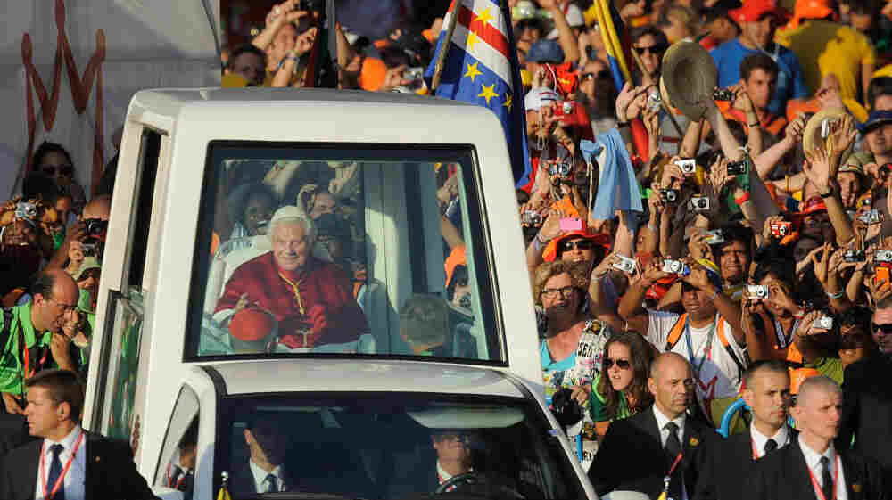 Young Catholics welcome Pope Benedict XVI as he arrives at Cibeles Square during World Youth Day celebrations on Aug. 18, in Madrid.