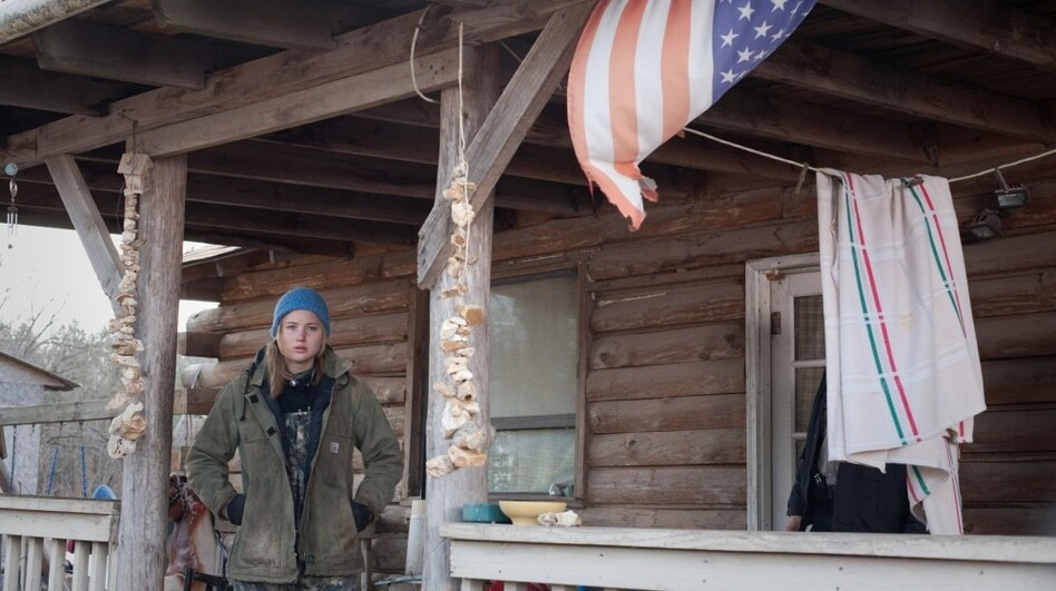 Jennifer Lawrence, as Ree Dolly in <em>Winter's Bone</em>, on the front porch of Frank Layson's house in southwestern Missouri. Layson's hand-built house served as the home for the Dolly children in the film.