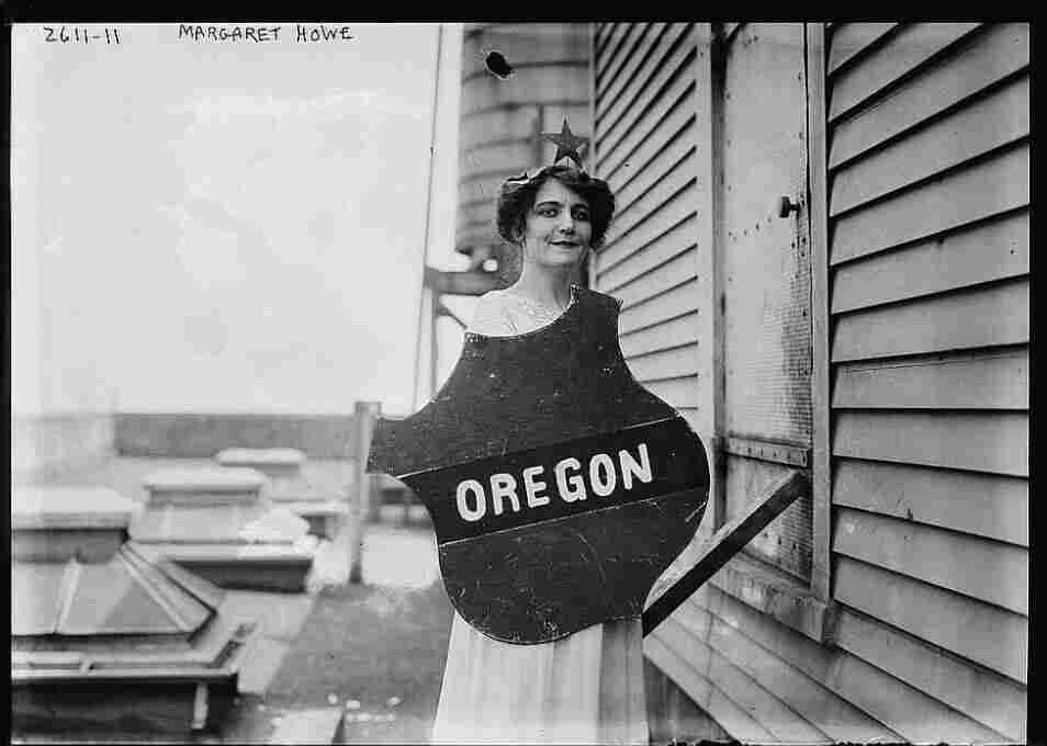 Actress Margaret Vale was the niece of President Woodrow Wilson and an active suffragist. Here she holds the emblem representing the Oregon delegation at a women's suffrage parade, 1913.