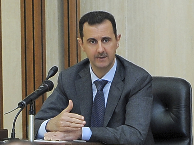 Syrian President Bashar Assad addresses a meeting of his Baath Party in Damascus, Syria, on Wednesday. President Obama called on Assad to step down, though it's not clear who would replace Assad if he quit or was ousted.