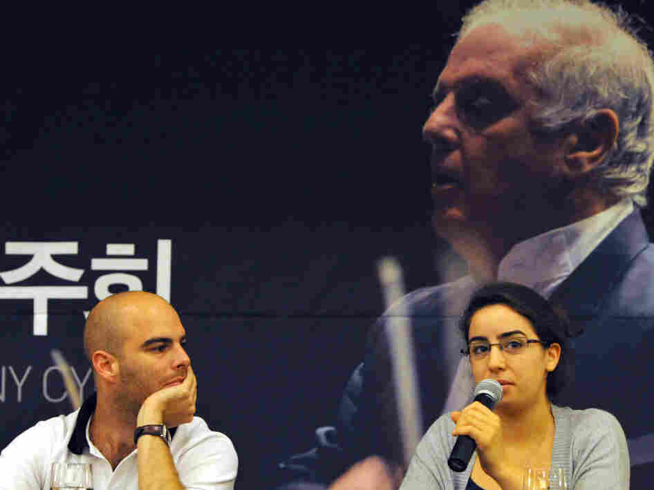 Israeli flutist Guy Eshed and Palestinian violinist Tyme Khleifi speak in Seoul in advance of a West-Eastern Divan Orchestra concert at the Korean border. near the border with North Korea next week.