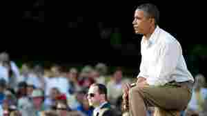 President Obama listens to questions at a town-hall-style meeting in Decorah, Iowa, on Monday. The president took a three-day bus tour through the Midwest to talk about the economy.