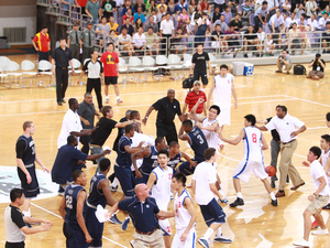 Basketball players from Georgetown University and China's Bayi Rockets team traded punches during their game, Thursday August 18, 2011.